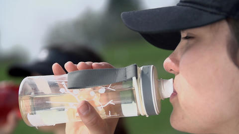 Close Up Drinking Bottled Water After Sport stock footage
