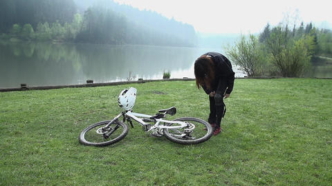 Dresing up for downhill bike driving Footage