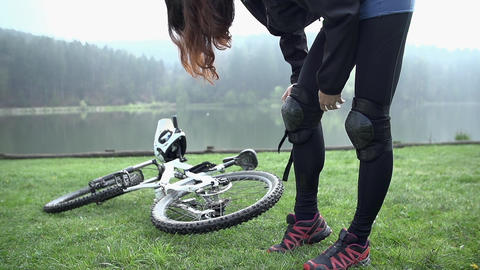 Girl protecting knee for bicycle downhill in slow  Footage