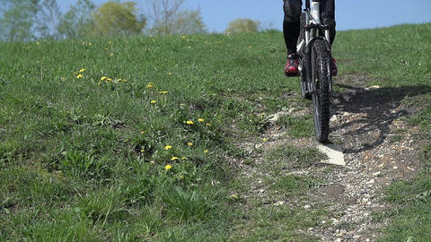 Braking down the hill with bicycle in slow motion  Footage