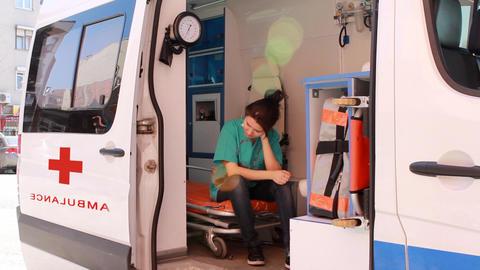 nurse thinking in ambulance 2 Footage