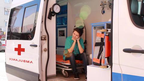 nurse thinking in ambulance 2 Stock Video Footage