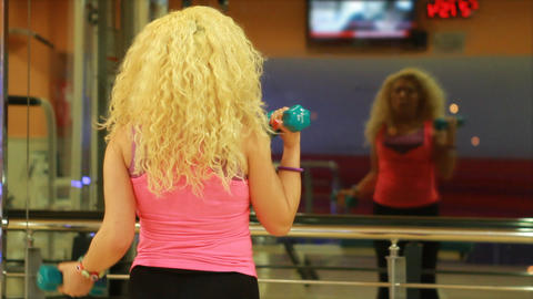 girl using dumbles in a gym 2 Footage