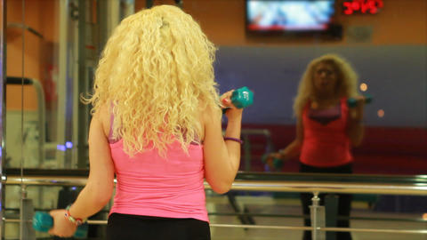 girl using dumbles in a gym 2 Stock Video Footage