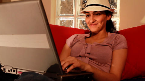 young woman on computer laughing 2 Footage