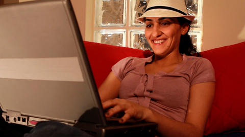young woman on computer laughing 2 Stock Video Footage