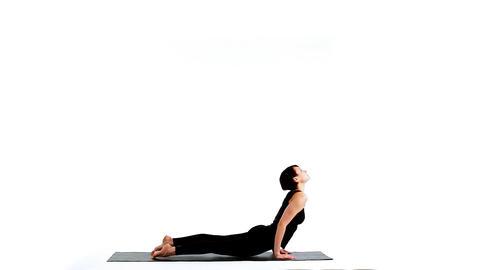 young beauty woman exercise sun salutation asana part3 Stock Video Footage