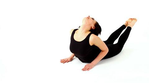 young woman make yoga asana - diagonal shot Stock Video Footage
