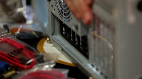 hands install back plate in computer case Stock Video Footage