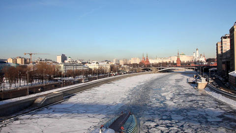Moscow Kremlin and boat in river at winter sunset Footage