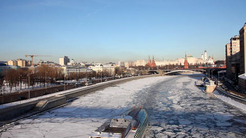 Moscow Kremlin and boat in river at winter sunset Stock Video Footage