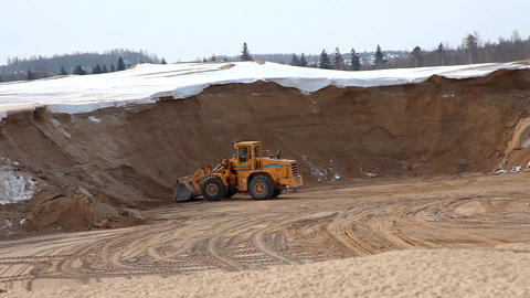 panorama on sandpit with tractor Stock Video Footage