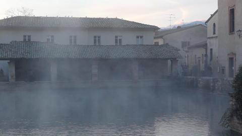 morning mist near water in obsolete backyard Stock Video Footage