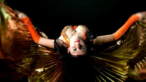 Arabic woman dancer flap with gold wing Footage