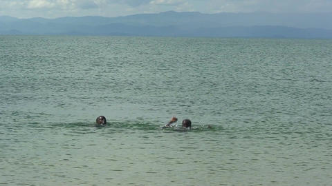 Malawi: african boys playing in a water Stock Video Footage