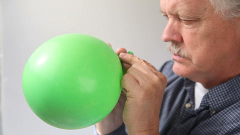 Man Lets Air Out Of Balloon stock footage