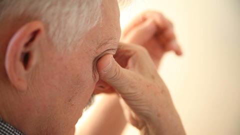 tired man rubs his eyes Footage