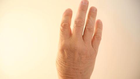 Senior Man Massaging Numb Hand stock footage