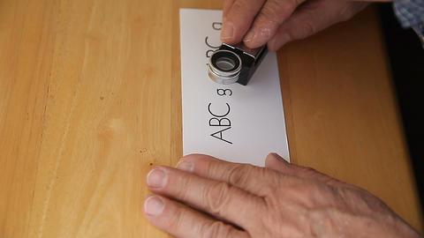 letterpress printer checks work with magnifier Footage