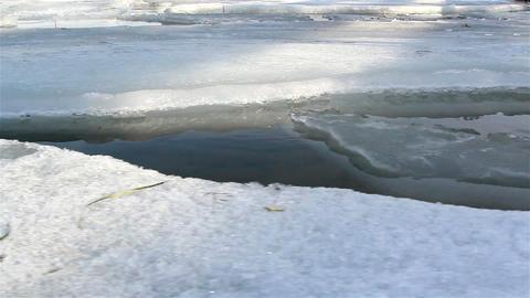 Few ice caps on water slowly melting Footage