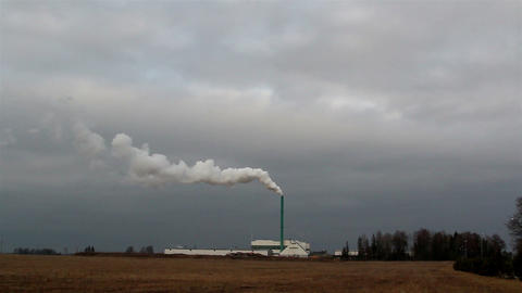 The view from afar of a smoke from a factory Footage