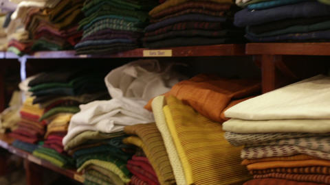 clothes lying on the shelves in the store Footage