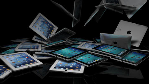 IPads Falling On A Reflective Stage stock footage