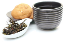 Loose Tea And Cup Of Tea, Rotation Of Tea on white Footage