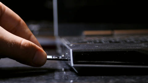 Hand Inserting Micro SD Card Into Laptop, Media, T Footage