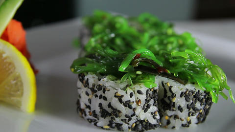 Delicious sushi rolls on plate decorated with wasa Footage