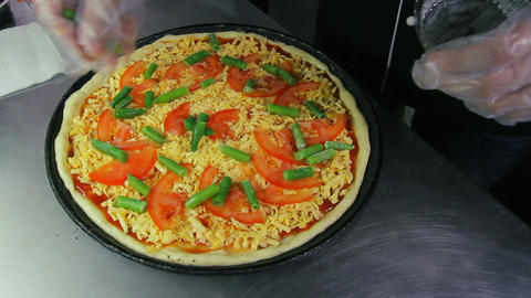 The chef puts green beans on pizza Footage