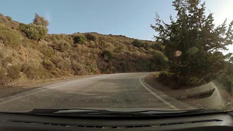 Windy road on arid hillside Footage