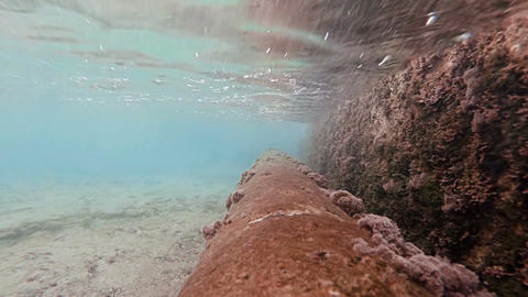 Rusty pipe in shallow water Footage