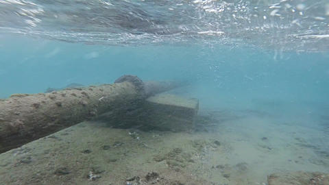 Rusty pipe under the surface of the ocean Footage