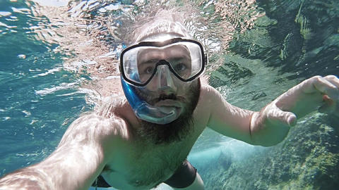 Man Snorkling POV stock footage