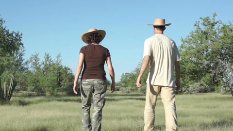 Couple Walking Outdoors in Arid Grasslands Footage