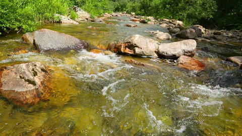 Mountain River Flowing Over Rocks In Summer - Slid stock footage