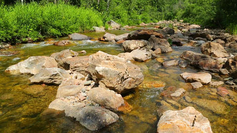 mountain river flowing over rocks in summer - slid Live Action