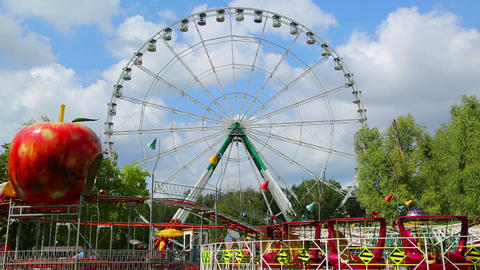 Ferris wheel and rides in the amusement park Footage