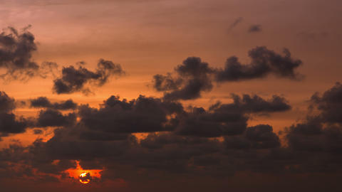 The sun sets in the cloud. Timelapse in orange ton Footage