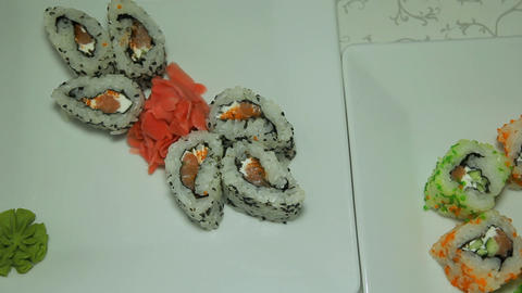 Panoraming shot of delicious sushi rolls on white Footage