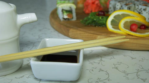 Dolly shot of delicious sushi rolls on wooden plat Footage