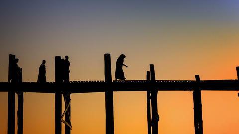 Amazing Silhouettes Of Monks On The Ancient Wooden stock footage