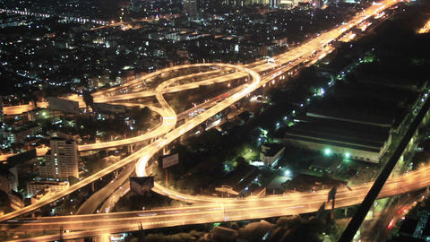 Top view on the night city and highways. Bangkok.  Footage