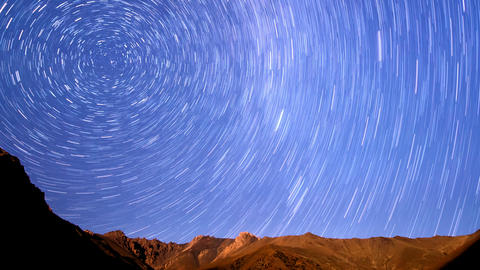 Stars over the mountains. Line. Time Lapse. 4K Footage