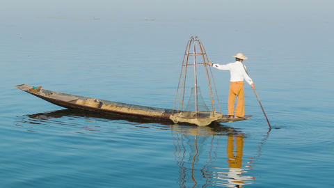 Burmese fisherman with a traditional trap on woode Footage