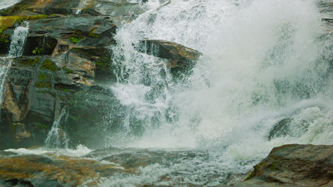 Water flowing over rocks. Waterfall on a small riv Footage