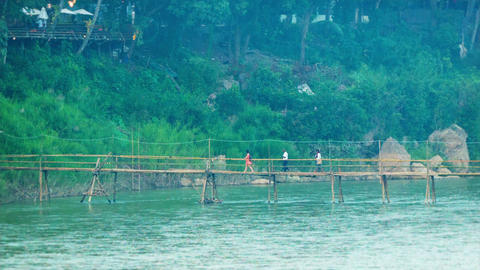People Cross The River With The Help Of A Bamboo F stock footage