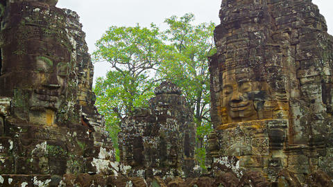 Towers of the ancient temple with stone faces. Cam Footage