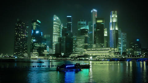 Night Singapore skyscrapers illuminated with light Footage